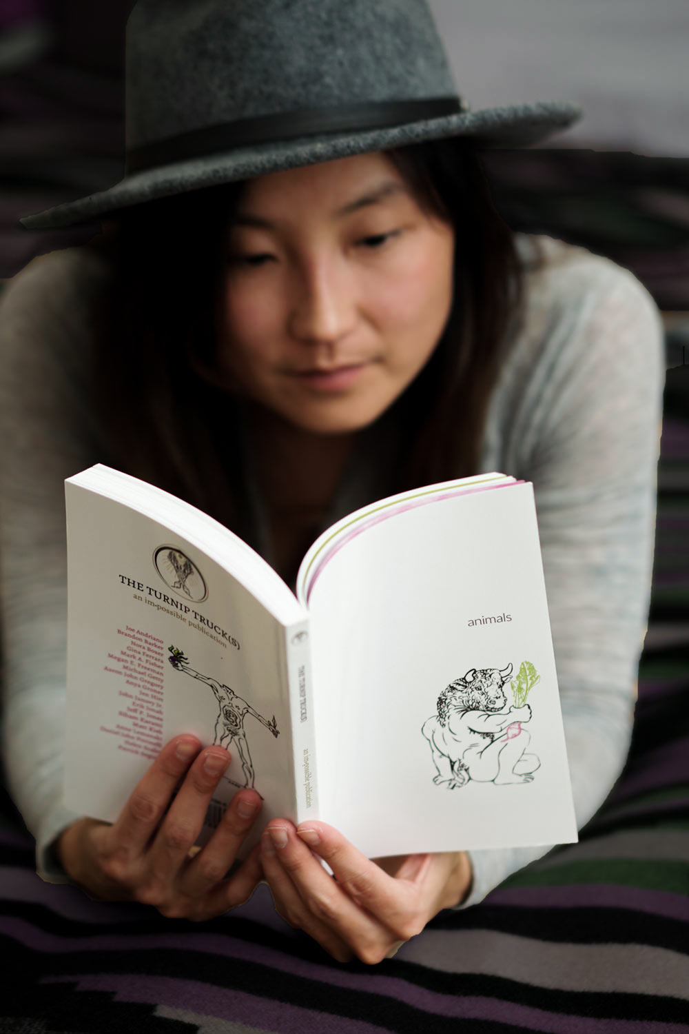 "A girl reading The Turnip Truck(s) ""Animals"" issue."